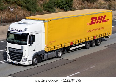 FRANKFURT AM MAIN, GERMANY - September 22, 2018: DHL truck on motorway. DHL is a division of the German logistics company Deutsche Post AG providing international express mail services.