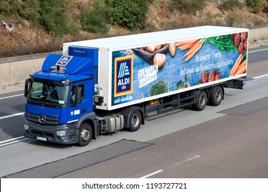 FRANKFURT AM MAIN, GERMANY - September 22, 2018: Aldi Süd truck on motorway. Aldi is a leading global discount supermarket chain with almost 10,000 stores in 18 countries.