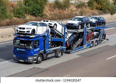 FRANKFURT AM MAIN, GERMANY - September 22, 2018: Globay truck on motorway. Globay is group of companies that provide automobile logistics solutions for car manufacturers, dealers and used car sellers.