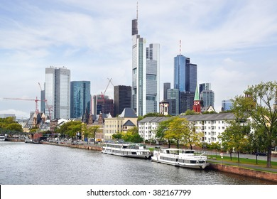 FRANKFURT AM MAIN, GERMANY - SEPTEMBER 26, 2012: Panorama of Frankfurt from Iron Bridge-Eiserner Steg is already well over 100 years old. View includes next buildings: Kaiserdom, Altstadt, Commerzbank Tower.