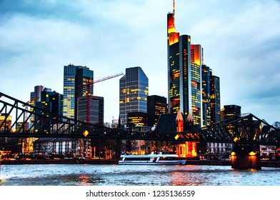 Frankfurt am Main, Germany. Skyline of Frankfurt, Germany in the evening with famous skyscrapers and river, cloudy sky