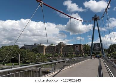 FRANKFURT AM MAIN, GERMANY-JUNE 07, 2017: staedel museum and pedestrian bridge holbeinsteg in frankfurt am main, germany