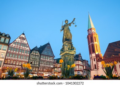 Frankfurt am Main, Hesse, Germany - April 11, 2010: Scales of Justice at Romerberg square, the old town center, and the Romer, with the Old Nikolai Church, Frankfurt, Hesse, Germany