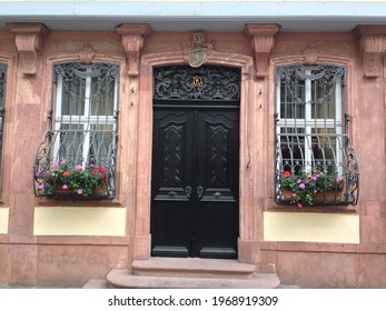 FRANKFURT AM MAIN, HESSE, GERMANY - JULY 5 2013: Front door and windows of the Goethe House, with window boxes and flowers  on Gro§er Hirschgraben street.