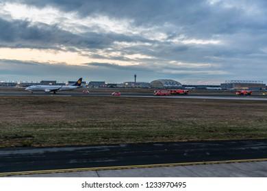 Frankfurt (Main) Hessen, Germany, 19. November 2018, Lufthansa City Line Embraer ERJ-190LR escorted by fire trucks after Emergency Landing on Runway 07C at Frankfurt Airport, EDDF (FRA)