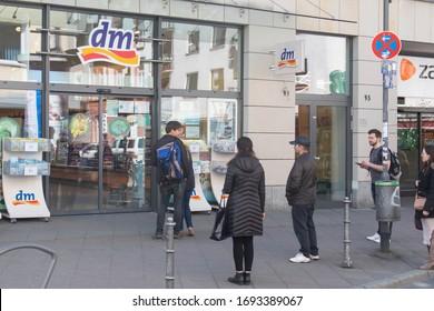 Frankfurt am Main, Hessen/Germany – 04/04/2020: People are waiting in line to enter a supermarket in Frankfurt Bockenheim during the Corona Virus Crisis.