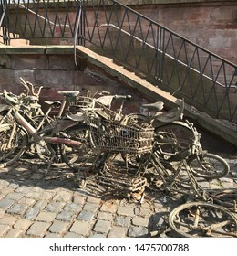 Frankfurt am Main, Hessen/Germany - August 10, 2019: Dirty bikes and shopping cart fished out of the Main river