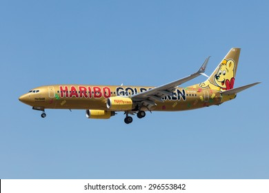 FRANKFURT MAIN - JULY 10: Boeing 737-800 airplane of the german airline TUIfly with a special Haribo paint. July 10, 2015 in Frankfurt Main, Germany. 