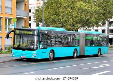 FRANKFURT AM MAIN - SEPTEMBER 16, 2013: MAN A23 Lion's City G articulated bus of Verkehrsgesellschaft Frankfurt am Main mbH bus company at Dortelweiler stra?e bus stop.