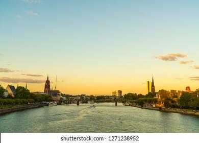 Frankfurt am Main skyline during twilight hour.