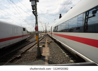 Frankfurt am Main,Germany-June 28,2018: An ICE High Speed Tran enters Frankfurt am Main Central station while another leaves at the same time from another track