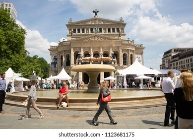Frankfurt am Main,Germany-June 28,2018: People enjoy the weather during their lunch break at square in front of the Frankfurt Opera House