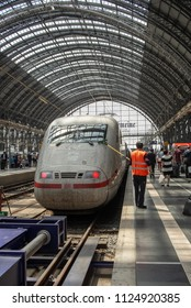 Frankfurt am Main,Germany-June 28,2018: A railroad employee cleans  an ICE train's windshield at Frankfurt am Main Central Station