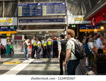 Frankfurt am Main,Germany-June 28,2018: Security guards from the  Deutsche Bahn. german railroad stand beneath a departures board at Frankfurt Main Central Station