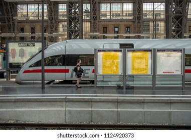 Frankfurt am Main,Germany-June 28,2018: A woman walks past an ICE high speed train at Frankfurt Central Station