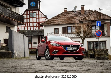 FRANKFURT - MARCH 21, 2014: All-new Mazda 3 1.5 Skyactiv at test-drive event held on March 21 near Frankfurt. The new Mazda 3 is one of the best-handling cars in its class.
