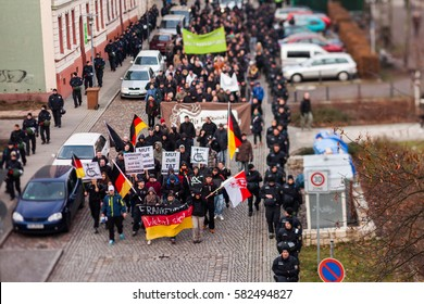 FRANKFURT (ODER), GERMANY - 17 January 2015: Right-wing demonstrators march through Frankfurt (Oder), Germany protesting against the German government and its liberal refugee policy on 15 January 2015