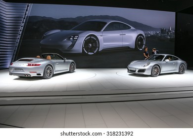 FRANKFURT - SEPT 16: Porsche 911 Carrera S Cabrio and 911 Carrera S shown at the 66th IAA (Internationale Automobil Ausstellung) on September 16, 2015 in Frankfurt, Germany.