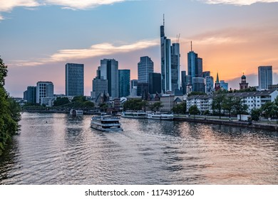 Frankfurt Skyline during the Sunset with a boat over the Main - The Sun goes Down - Skyscraper Panorama - Frankfurt am Main, Hessen, Germany at Night