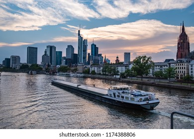 Frankfurt Skyline during the Sunset with a cargo ship over the Main - Frankfurt am Main, Hessen, Germany at Night