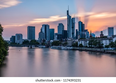 Frankfurt Skyline during the Sunset - Frankfurt am Main, Hessen, Germany at Night - The last rays of sunshine of the day shine out from behind the skyscrapers
