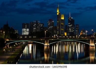 Frankfurt Skyline at night with illuminated office buildings