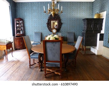 "FRANKFURT-AM-MAINE, GERMANY - MAY 9, 2014. Blue Room at Goethe-Haus in Frankfurt, with furniture. The story goes that Goethe completed final draft of ""Goetz of Berlichinger"" done at round dining table"