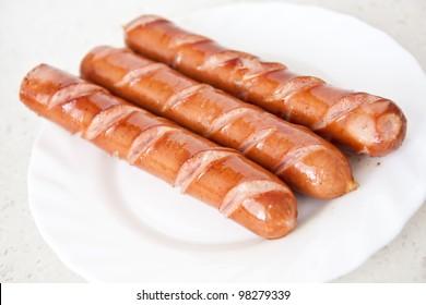 frankfurter sausage hot dog food at plate