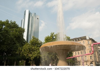 FRANKFURT/GERMANY 26 AUGUST 2017: Close shot of fountain in Opernplatz Frankfurt with Deutsche Bank Twin Towers in the background