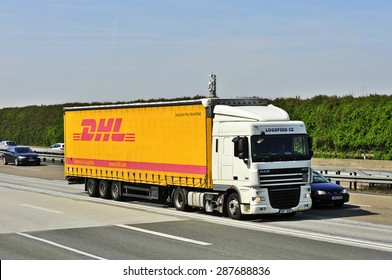 FRANKFURT,GERMANY - APRIL 10: DHL delivery truck on the highway on April 10,2015 in Frankfurt, Germany. DHL is a world wide courier company that operates in 220 countries with over 285,000 employees.
