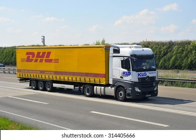 FRANKFURT,GERMANY - AUG 21: DHL delivery van on the highway on August 21, 2015 in Frankfurt, Germany. DHL is a world wide courier company that operates in 220 countries with over 285,000 employees.