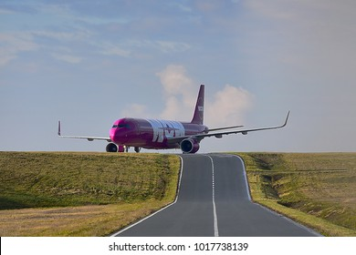 FRANKFURT,GERMANY-FEBRUARY 03,2018: WOW air TF-MOM Airbus A321 lands at Frankfurt airport.WOW air is an Icelandic low-cost carrier focusing on transatlantic flights.