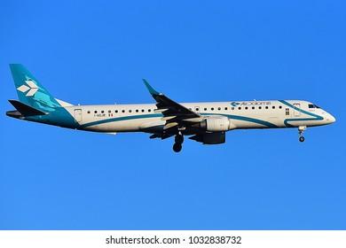 FRANKFURT,GERMANY-FEBRUARY 24,2018:  Air Dolomiti Embraer ERJ-195  lands at airport.Air Dolomiti  is an Italian regional airline in Dossobuono, Italy.