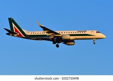 FRANKFURT,GERMANY-FEBRUARY 24,2018:  EI-RNA Alitalia Cityliner Embraer ERJ-190STD lands at airport.