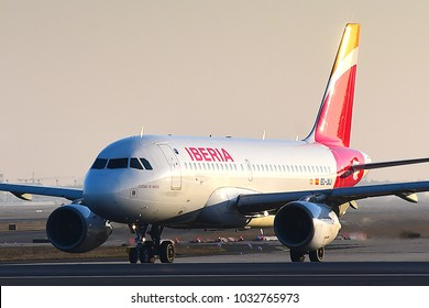 FRANKFURT,GERMANY-FEBRUARY 24,2018:  Iberia Airlines Airbus A319 lands at airport.Iberia Airlines is the flag carrier airline of Spain.