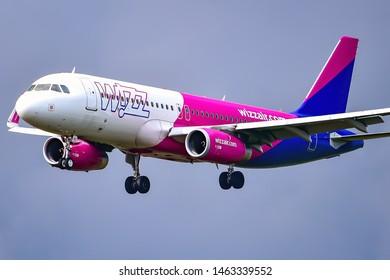 Frankfurt,Germany-July 13,2019:Wizz Air HA-LYV Airbus A320 over airport.