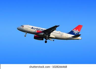 FRANKFURT,GERMANY-JULY 21,2017: Air Serbia YU-APD Airbus A319 lands at Frankfurt airport.