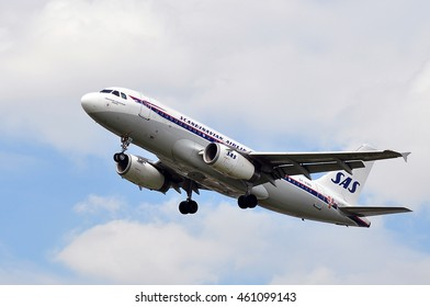 FRANKFURT,GERMANY-JULY 28:SAS Airbus A319 above the Frankfurt International Airport on July 28,2016 in Frankfurt,Germany.Scandinavian Airlines or SAS is the flag carrier of Sweden, Norway and Denmark.