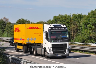 FRANKFURT,GERMANY-JULY 31:DHL delivery truck on the highway on July 31,2015 in Frankfurt,Germany.DHL Express is a division of the German logistics company providing international express mail services