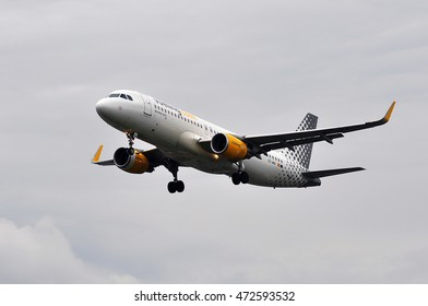 FRANKFURT,GERMANY-JUNE 023:Vueling Airlines Airbus A320 above airport on June 02,2016 in Frankfurt,Germany.Vueling Airlines is a Spanish low-cost airline.