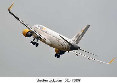 FRANKFURT,GERMANY-JUNE 02:Vueling Airlines Airbus A320 lands at airport on June 02,2016 in Frankfurt,Germany.Vueling Airlines is a Spanish low-cost airline.