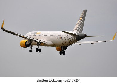 FRANKFURT,GERMANY-JUNE 02:Vueling Airlines Airbus A320 above airport on June 02,2016 in Frankfurt,Germany.Vueling Airlines is a Spanish low-cost airline.