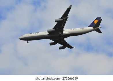 FRANKFURT,GERMANY-MARCH 28:Airibus A340-300 of Lufthansa above the Frankfurt airport on March 28,2015 in Frankfurt,Germany. Lufthansa AG is a German airline and also the largest airline in Europe.