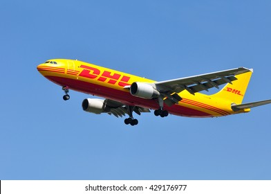 FRANKFURT,GERMANY-MAY 26:airplane of DHL Express above the Frankfurt airport on May 26,2016 in Frankfurt,Germany.DHL Express is a division of the German logistics company Deutsche Post DHL.