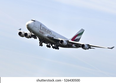 FRANKFURT,GERMANY-MAY 26:EMIRATES AIRLINES Sky Cargo Boeing 747 approaching Frankfurt airport on May 26,2016 in Frankfurt,Germany.Emirates is an airline of the United Arab Emirates, based in Dubai.