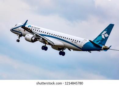 FRANKFURT,GERMANY-OCTOBER 25,2018:Air Dolomiti Embraer ERJ-195.Air Dolomiti S.p.A. is an Italian regional airline with its head office in Dossobuono, Villafranca di Verona, Italy.