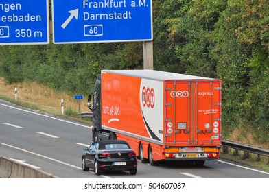 FRANKFURT,GERMANY-SEPT 15: TNT truck on the highway on September 15,2016 in Frankfurt,Germany. TNT is an international courier delivery services company with headquarters in Hoofddorp, Netherlands