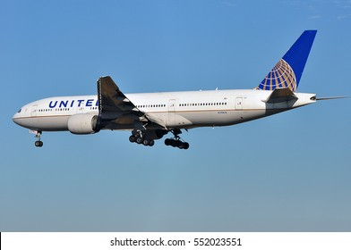 FRANKFURT,GERMANY-SEPT 29:United Airlines Boeing 777 over the Frankfurt airport on September 24,2015 in Frankfurt,Germany. United is a major American airline carrier headquartered in Chicago,Illinois.