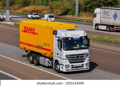 Frankfurt,Germany-September 01,2016:DHL delivery truck on the route.DHL Express is a division of the German logistics company Deutsche Post.
