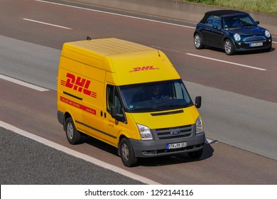 Frankfurt,Germany-September 01,2016:DHL delivery van on the route.DHL Express is a division of the German logistics company Deutsche Post.